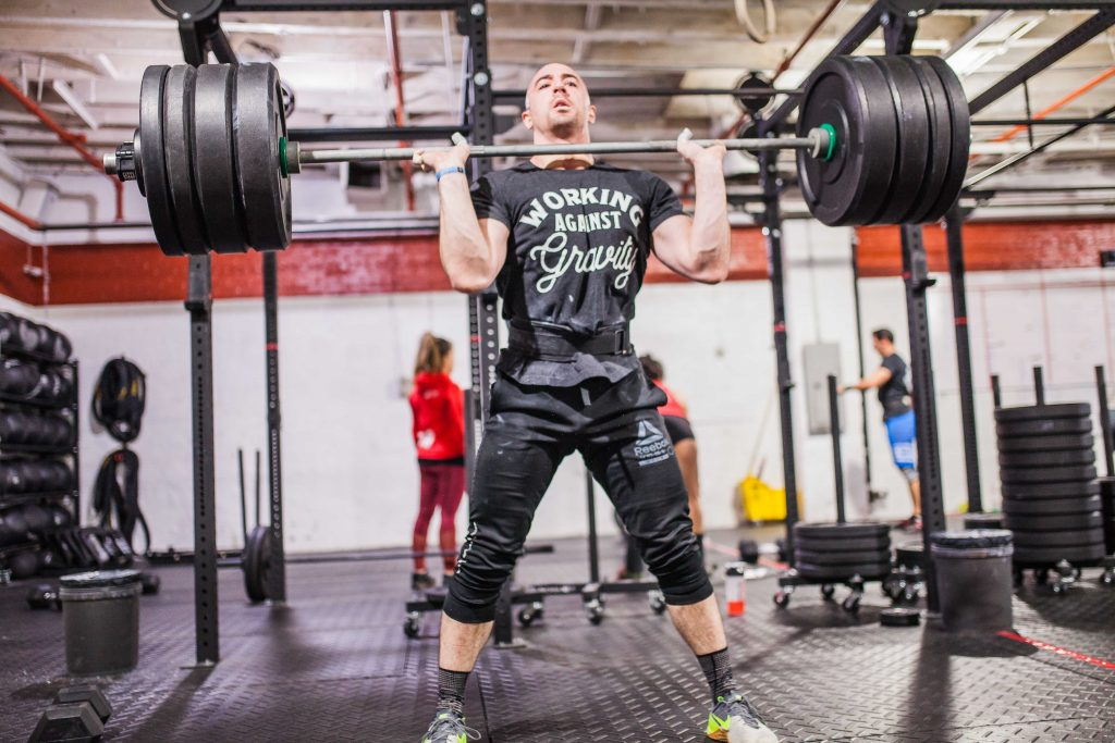 Cleans during the CrossFit Games Open 18.2 at CrossFit Bell